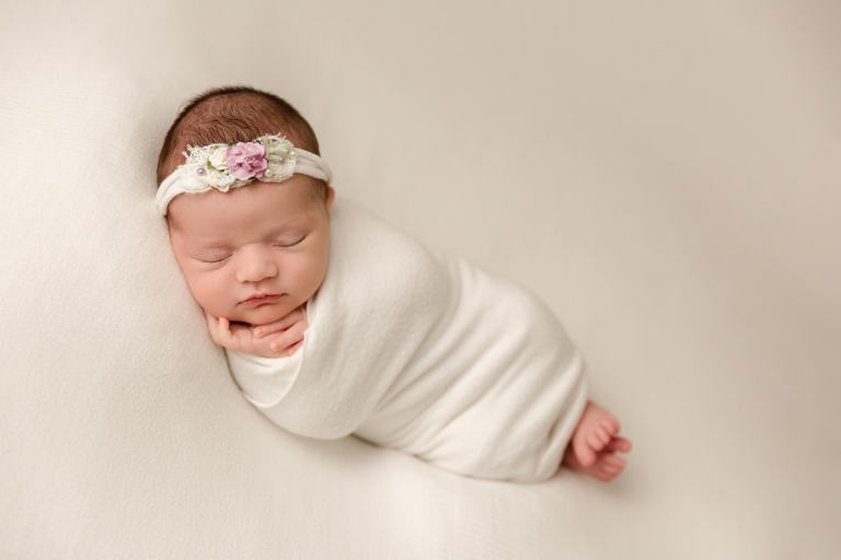newborn girl in white and pink