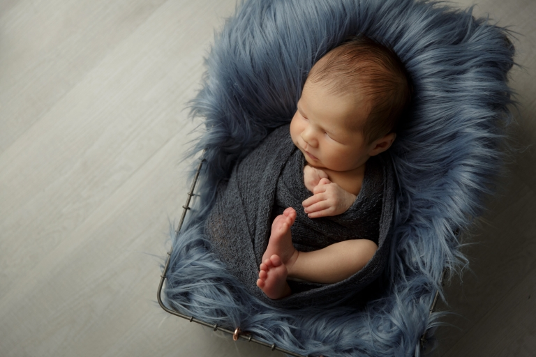 newborn boy in blue and gray