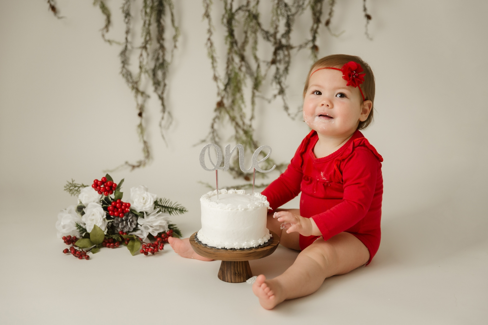 baby girl in red wood cake smash