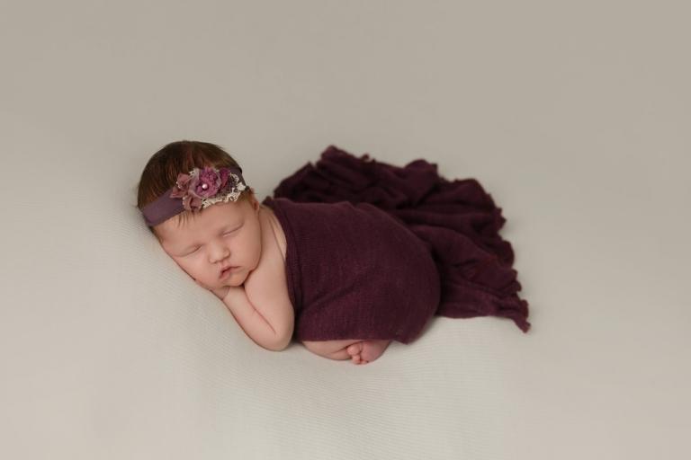 posed newborn baby girl minneapolis newborn photographer