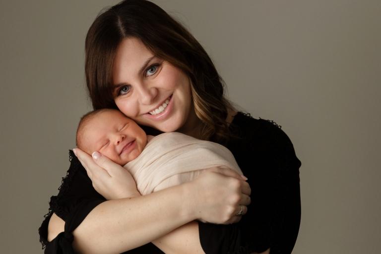 mom and newborn baby girl smiling minneapolis newborn photographer